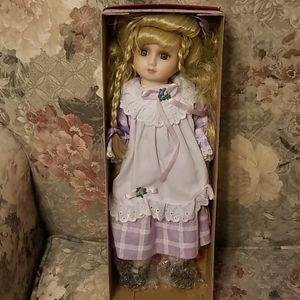 Brinn's Porcelain musical doll